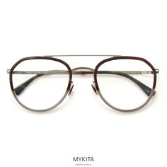 The MYKITA // JARMO represents one of the lightest glasses by MYKITA. The aviator shape is crafted out of slender stainless steel with acetate inserts offering supreme comfort in a refined aesthetic.