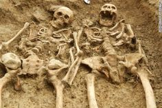 Skeletons found 'holding hands' for 700 years