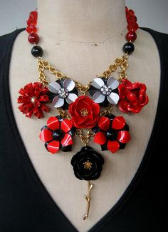 This striking design is comprised of red and black vintage flower earrings and brooches from the 1960s and 70s. I have removed their pins and
