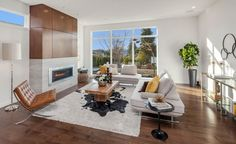 living room furniture ideas barcelona chair black side table contemporary sofa cow hide rug gasworks gallery glass console table home staging house plant of Creating A Good Looking Living Room Using These Impressive Furniture Ideas
