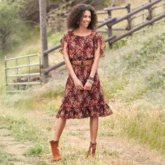 FLOWER SHOWER SILK DRESS--Our slip-on print makes a splash with oh-so-pretty details—smocking at waist, ruffled hem, petal-slit sleeves cut to flatter. Lined. Dry clean. Imported. Sizes XS (2), S (4 to 6), M (8 to 10), L (12 to 14), XL (16). Approx. 41-1/4L.