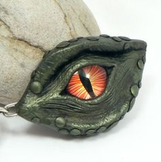 Green Dragon's Eye Pendant With Iridescent Skin And A Fiery Red Eye