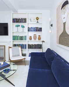 A carefully curated built-in bookcase leaves plenty of room for display without taking up space on the floor in a Manhattan apartment designed by Ashley Darryl. | archdigest.com
