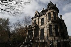 Franklin Castle has a tower, turrets, balconies, stone outcroppings, gargoyles, wrought-iron fixtures and fences.The Gothic-style Franklin Castle is said to be Ohio's most haunted home.  Built in 1860 for Hannes Tiedemann. On January 15, 1891, Tiedemann's 15-year-old daughter Emma succumbed to diabetes. Over the next three years Tiedemann would bury his mother and three more children, giving rise to speculation that there was more to the deaths than met the eye.