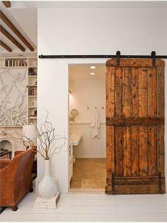 Ideas for Bedroom Decor: Stained wood barn door, interior barn door