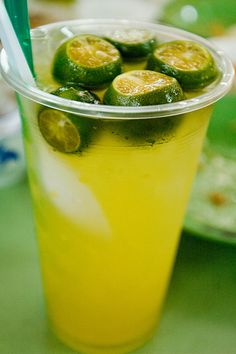 CALAMANSI JUICE ~~~ calamansi is a variety of lime popular in southeast asia; they start out green and, if left on the tree, mature into a shade of orange. the flavor profile leans toward sour with a bit of sweetness. the above image reflects a version found in singapore.