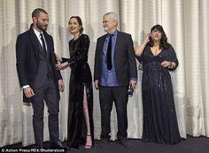 Backstage: Jamie and Dakota were playful as they stood besideJames Foley and E L James