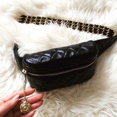 Authentic Chanel vintage fanny pack/waist bag. Authentic CHANEL Vintage Lambskin Belt Bag Fanny Pack in Black. This luxury waist bag is elegantly crafted of soft diamond quilted lambskin and features a front zipper with camellia flower, leather side trim and a gorgeous triple chain and leather belt. The interior compartment is a soft black leather. Fits up to a 28inch waist. Bag part is approx 10inch length x 5 inch height x 2.5 inch depth. Beautiful pre loved condition!! CHANEL Bags Wallets