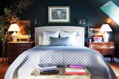 Dark, moody master bedroom with contrasting bedside tables