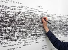"""""""Over the course of the exhibition, attendants mark Museum visitors' heights, first names, and date of the measurement on the gallery walls. Beginning as an empty white space, over time the gallery gradually accumulates the traces of thousands of people."""" by Roman Ondak.    http://www.moma.org/visit/calendar/exhibitions/980"""