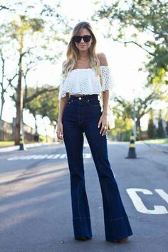 Off the shoulder lace top + high-waisted bell bottom jeans.