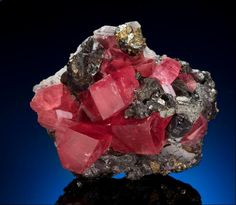 """Rhodochrosite Many mineral collectors want to own at least one piece of rhodochrosite. This one comes from the Sweet Home Mine in Colorado, now closed. Measures: 2 1/2"""" x 2"""" x 1 1/2 Estimate: $28,000-$32,000"""