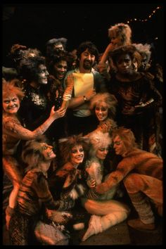 """Director Trevor Nunn surrounded by cats from the Broadway musical """"Cats."""" (New York) - 1982"""