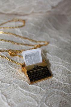 Such a cute necklace!  The Writer - Gold Plated Typewriter Necklace. $24.00, via Etsy.