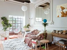 Creating Paris vibes in Spain. This apartment in a 50's building in Coruña was transformed into a chic, eclectic space with finds from antique shops and flea markets by design firm Ramisa Projects & F