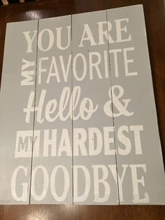 """Hand-painted wooden sign. Reads """"You are my favorite hello and my hardest goodbye""""."""