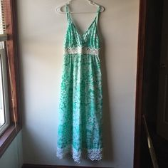 "1 day sale! RARE ""The Lilly"" Lilly Pulitzer maxi AMAZINGLY GORGEOUS and super rare ""The Lilly"" label late 1960s vintage Lilly Pulitzer maxi with lace detail at hem and around waist, no size, but would fit around a Medium give or take for bust size, tiny stain on the lace in the back but barely noticeable and does not take away from the dress at all!! amazing piece of Lilly to add to your collection! Still in love with it so price is pretty firm  Lilly Pulitzer Dresses Maxi"