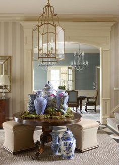Ginormous Greenwich, Connecticut foyer by Cindy Rinfret with beautiful striped paper, lovely millwork, giant lantern, and a whole store's worth of blue and white jars!
