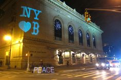 "A sign saying ""New York Loves Boston"" is projected on the facade of the Brooklyn Academy of Music, in New York, late on April 15, 2013, hours after the bombings of the Boston Marathon. The work was done by the Illuminator, a guerrilla projection van that was a project of Occupy Wall Street, and members of the the OWS Light Brigade. (© Lucky Tran, The Illuminator collective)   In Focus - The Atlantic"