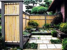 Beautiful idea for how to design yard with bamboo fence - link connects you with how to clean bamboo fencing