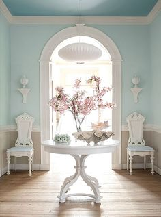 Front hall with pastel accents and center table