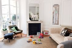 The Paris apartment of Chloé creative director Clare Waight Keller is both stylish and kid-friendly; the clean lines of her furniture, paired with Jonathan Adler needlepoint pillows, highlight the architectural details of the 19th-century space.