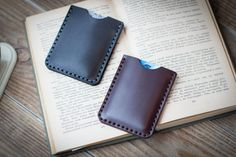 Leather credit card wallet. Comes in 2 colors : Black and Brown Oxblood. Has 2 pockets. Will fit Up to 10-12 credit cards in total or 5-6 credit cards in one pocket and cash in another. Can make a great personalized gift. Made to last. ___________________________________________________________________________ Designed and hand made at viveo studio. Please have a look at our workshop and the process of creating leather goods. https://blog.etsy.com/en/2014/featur...