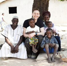 """Spending time with a family in the village of Loppe. Tom Hiddleston's Guinea field diary: Day 3. """"To set the scene. Since we left Conakry, we have been driving east, driving deep into the most impoverished parts of the country, where terrain is arid, burned and rough. The road is red and dusty. On either side the land is dry and charred. We are heading east towards the border with Mali,..."""" (http://blogs.unicef.org.uk/2013/01/27/tom-hiddlestons-guinea-field-diary-day-3/)"""
