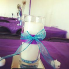 Simple centerpiece for my peacock, turquoise & purple wedding reception