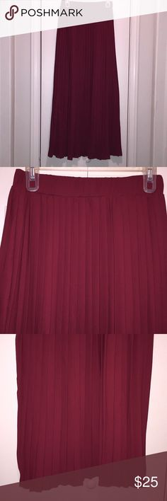 NWOT! Burgundy Pleated Maxi Skirt Gorgeous Pleated Maxi skirt. Very flowy and fully lined underneath. Hanging in my closet and hasn't been worn. Needs a new home! ❤️ Excellent condition! Skirts Maxi