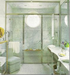 Marble & round window to fill the room with lovely natural light