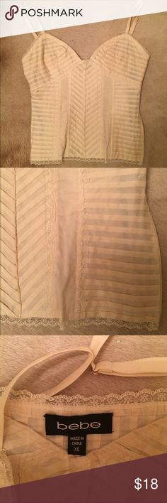 Cream ribbed Bebe tank This is just beautiful! Stunning and never worn. It's perfect to layer or wear alone. I hope you can show this beauty some more love! Zipper on side. Fits xs best. Bundle to save. bebe Tops Camisoles