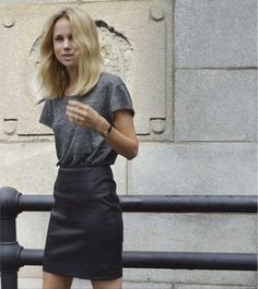professional and put together in a gray t-shirt and a black skirt