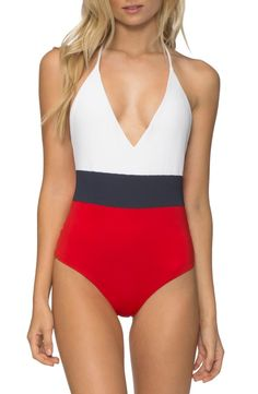This plunging, color blocking, one piece swimsuit with open back is sure to make a statement