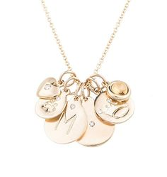 Helen Ficalora'såÊessential 14k yellow gold charm necklace features six of ouråÊmost coveted 14 karat yellow gold charms and makes aåÊbeautiful gift for any occasion such as birthdays, baby showers, a