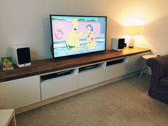 Long TV unit. Custom built IKEA Hack using Besta units on bespoke frame and the finished with a solid iroko worktop.