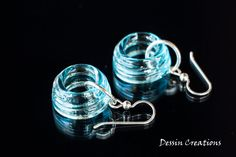 Topaz Blue Earrings made from a Recycled Glass Bottle.  It used to be a tiny Bombay Sapphire Gin Bottle, now it's Eco-Fabulous!