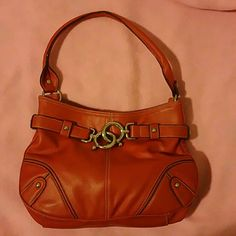 Nine west shoulder bag Used in great condition Leather in red, with magnetic closure, with side pockets inside and zip pocket as well.  Has pen mark infront. No trades Price firm Nine West Bags Shoulder Bags