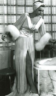 Actress Carole Landis wearing a beautiful negligee, circa 1940s.