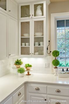 This Classic White Kitchen With Fresh Accents And Open, Glass Louvered  Cabinets And Subway Tile Part 55