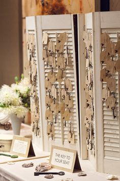 Use some window shutters for a super unique  DIY escort card holder!! Check out more awesomely affordable wedding ideas from real budget savvy brides!