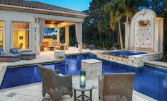 This lovely outdoor space was featured in the May 2016 Suncoast edition of HOME & DESIGN Magazine. To see other featured homes with stunning architecture, interior design, and landscaping visit http://www.homeanddesign.net/balancing-act/ #naples #florida #pool #poolhome #blue #outdoor #indooroutdoor #outdoorliving #outdoorspaces #relaxation #waterfeature #outdoortv #outdoorfurniture #patio #patiofurniture #pebbletek #pebble