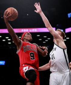Rajon Rondo #9 of the Chicago Bulls puts up a layup against Justin Hamilton #41 of the Brooklyn Nets during the second half at Barclays Center on October 31, 2016 in New York City. NOTE TO USER: User expressly acknowledges and agrees that, by downloading and or using this photograph, User is consenting to the terms and conditions of the Getty Images License Agreement.