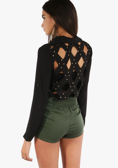 This top features an unique design.A button up with a crisp collar look.A diamond cut up back with gold studsto create a sexy look.Lightweight.-23