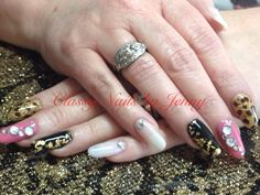 Shellac,gold leafing,freehand art and stones on natural nails