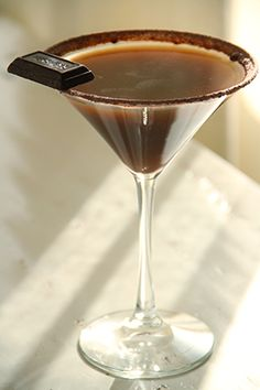 Hershey's Special Dark Martini Chocolate syrup and cocoa powder, for garnish Hershey's Special Dark Miniature bar, for garnish 1 ounce 360 Chocolate Vodka 1 ounce Marie Brizard Chocolat Royal Liqueur 1 ounce Jacquin's Creme de Cacao Dark 1 ounce Thatcher's Organic Artisan Dark Chocolate Liqueur