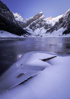 Frozen Seealpsee in the Alpstein mountains of Switzerland.
