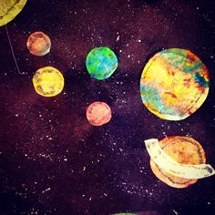 Tissue paper solar system ......  Kindergarten art :) this cool project we will need, #25 8x11 blk construction paper, various colored cray paper, glue stick, and white crayon. we will cut the planets out first, then cray paper them, then glue stick them onto the paper, make our stars, and wala it should be great.