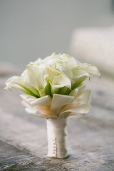 luxury white calla lily wedding bouquet with loops of white ribbon love the ribbon loops Calla Lillies Wedding, Lily Bouquet Wedding, Calla Lily Bouquet, Beach Wedding Flowers, White Wedding Bouquets, Bride Bouquets, Bridesmaid Bouquet, Floral Wedding, Calla Lilies