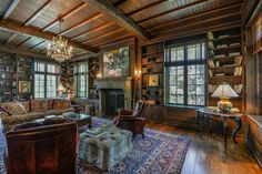 In the formal living room the walls are paneled in chestnut. It has a coffered and beamed ceiling and a tall 18th century fireplace imported from Germany.